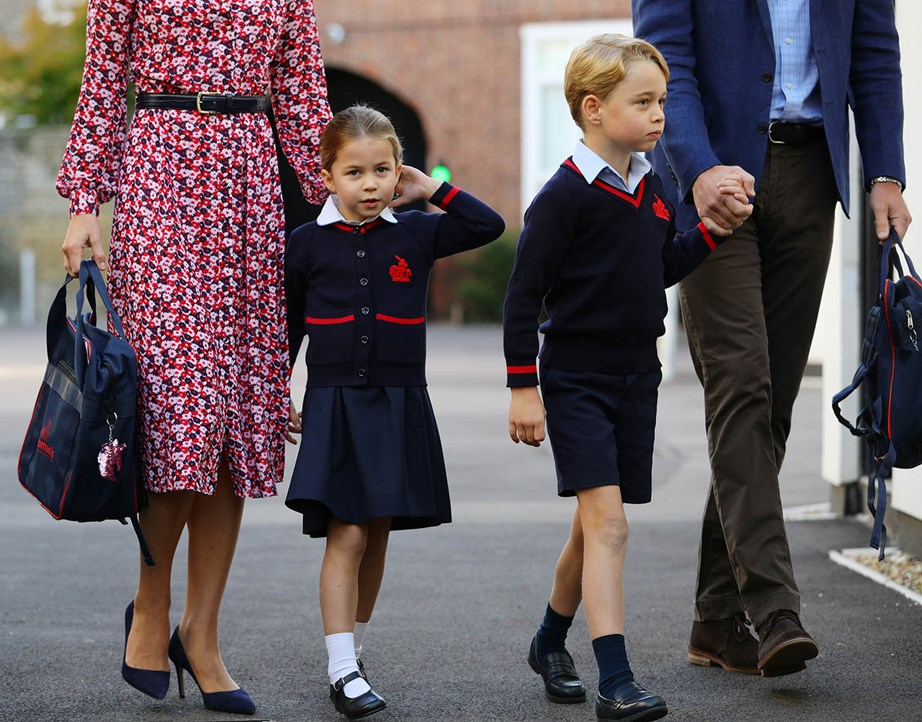 Hand-in-hand with their proud parents, the two eldest Cambridge children were all set for school. *(Image: Getty)*