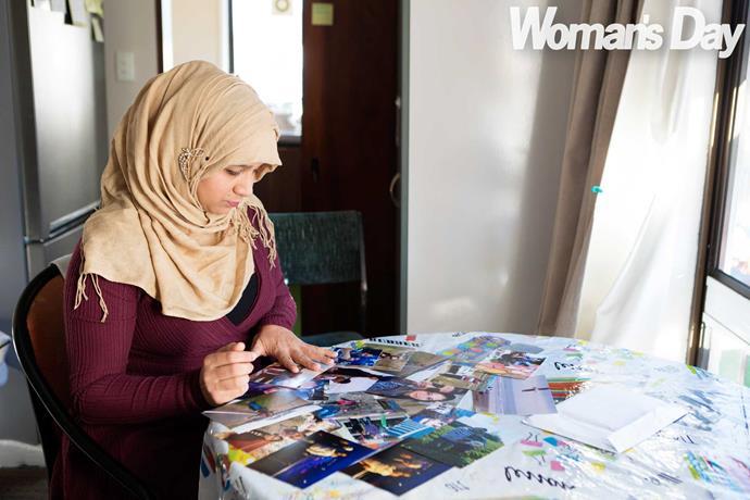 Khusbu looks at treasured photos of her husband.