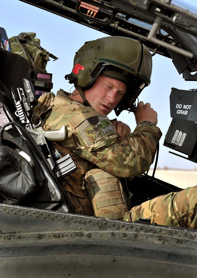 Prince Harry during his second tour in Afghanistan as an Apache pilot in 2012. *(Image: Getty)*