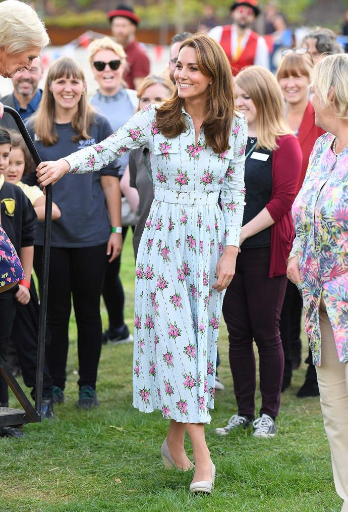 Kate looked gorgeous in an Emilia Wickstead number as she unveiled her latest 'Back to Nature' garden in Surrey. *(Image: Getty)*