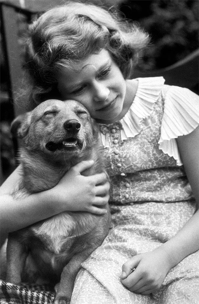 Princess Elizabeth with a beloved pet in 1936.