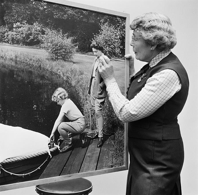 Lisa retouching a photo of the Queen and Anne in 1960. *Image: Getty*