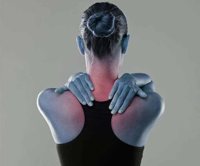 Woman rubbing inflamed neck pain