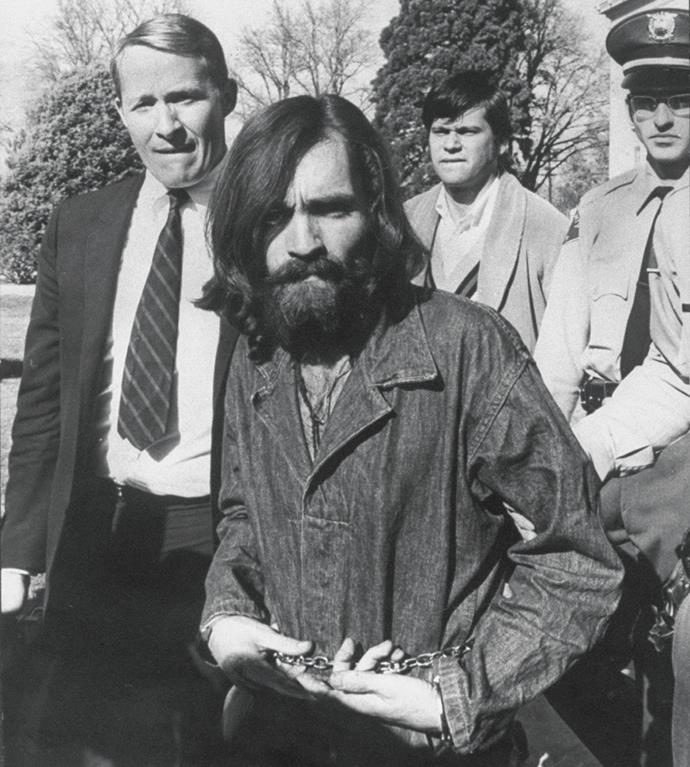 Charles Manson being led from a courthouse in December 1969