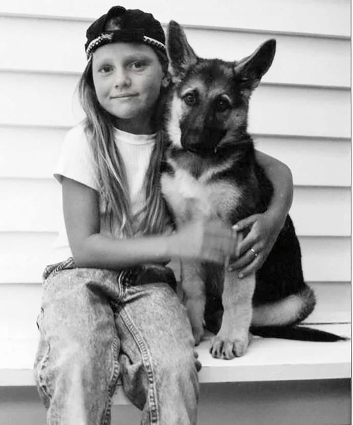 Young Gemma and her German shepherd, Gina.