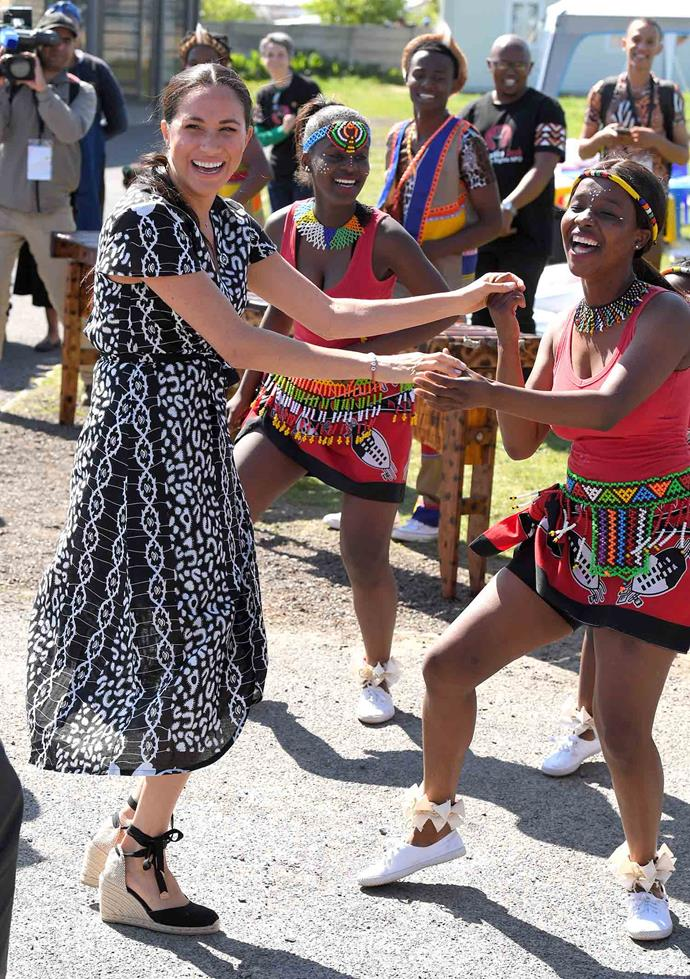 Day 1 of the Sussexes' royal tour of southern Africa kicked off with plenty of fun. *(Image: Getty)*