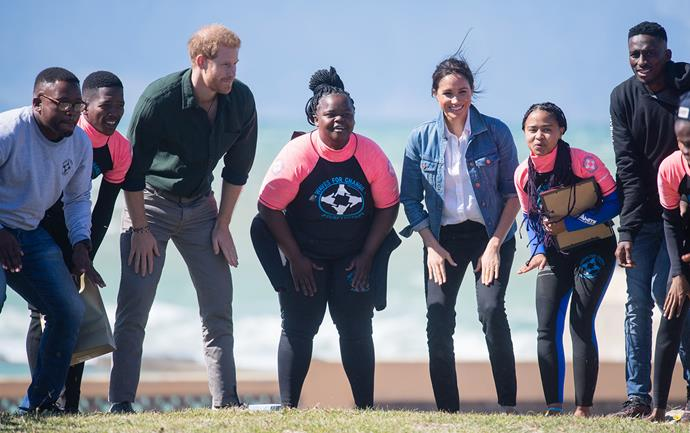 Harry and Meghan take part in a mindfulness workshop with a group of young South Africans and the NGO Waves for Change. *(Image: Getty)*