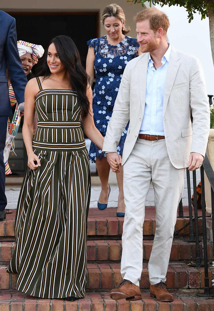 Meghan looked radiant, re-wearing her Martin Grant maxi dress, which she wore in Sydney in 2018. *(Image: Getty)*