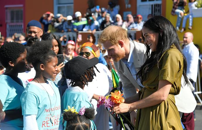 Meghan and Harry stopped to chat to the team at the Brave Foundation, who help to support survivors of physical trauma, injury and chronic disease. *(Image: Getty)*