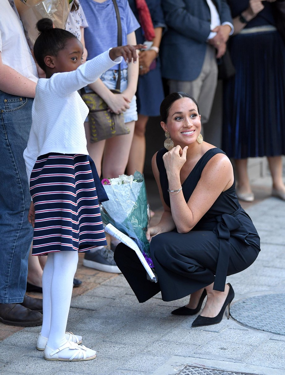 Earlier in the week Meghan visited mothers2mothers in Cape Town, a charity which trains and employs women living with HIV as frontline health workers. *(Image: Getty)*