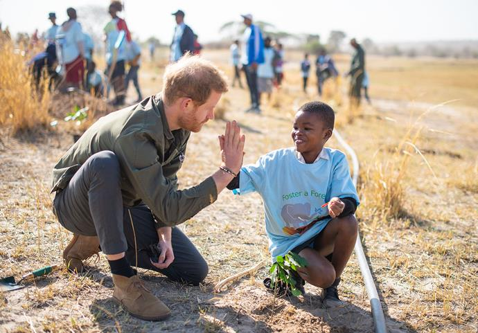 Prince Harry planting tree with school children last week in Botswana. *(Image: Getty)*