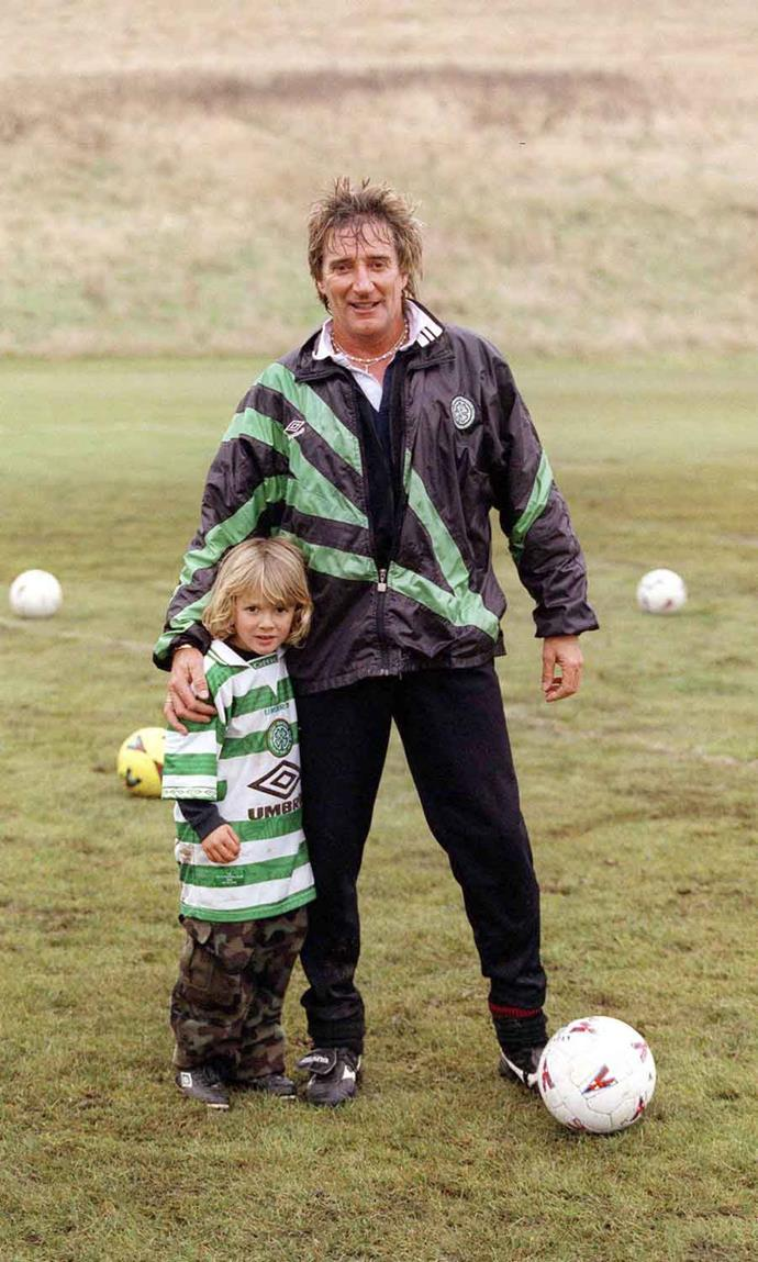 Kicking a ball with footy-mad dad Rod. *Image: Getty*