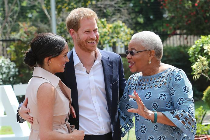 Meghan and Harry meet Graca Machel, the widow of the late Nelson Mandela. *(Image: Getty)*