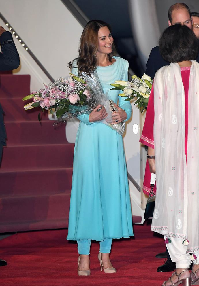 Kate looked gorgeous in a bespoke dress and pant ensemble by Catherine Walker, inspired by the traditional  shalwar kameez. *(Image: Getty)*