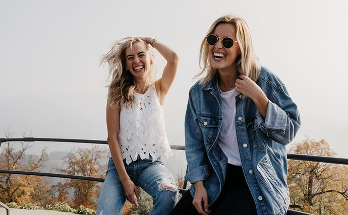 two women smiling in nature