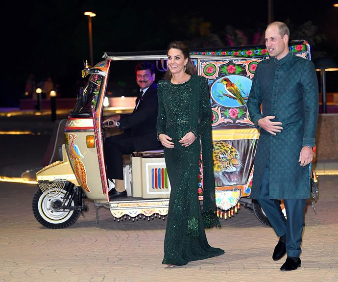 Prince William and Kate were visions in green as they arrived by tuk-tuk at the iconic Pakistan Monument in Islamabad for a special reception. *(Image: Getty)*