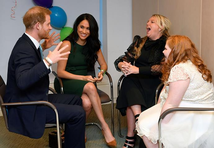 Harry and Meghan chatted with 11-year-old Milly and her mum Angela at the WellChild Awards. *(Image: Getty)*