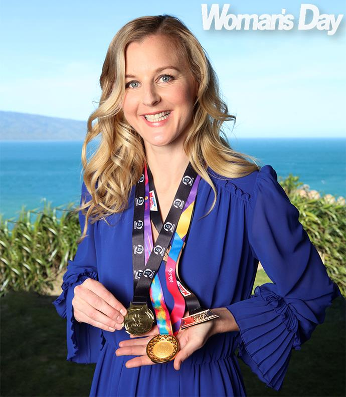 """""""I'm so content,"""" Katrina says, showing off her trio of gold medals"""