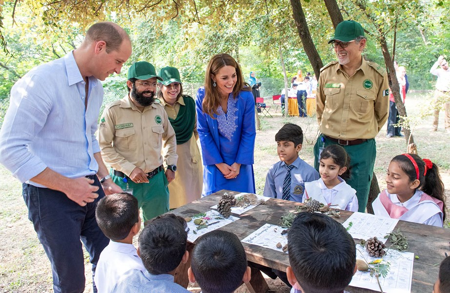 William and Kate join children taking part in a conservation activity at Margalla National Park, where William revealed Prince George is a huge fan of lizards. *(Image: Getty)*