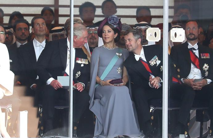 Prince Charles sat alongside Crown Princess Mary and Crown Prince Frederick of Denmark during the ceremony. *(Image: Getty)*