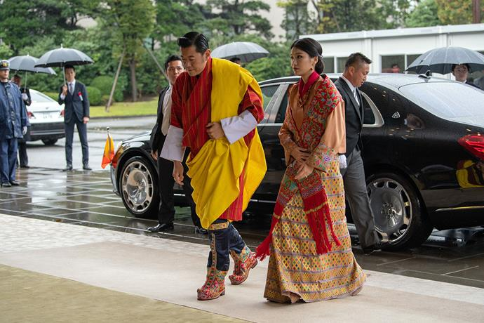 King Jigme Khesar Namgyel Wangchuck and Queen Jetsun Pema of Bhutan arrive at the Enthronement Ceremony. *(Image: Getty)*