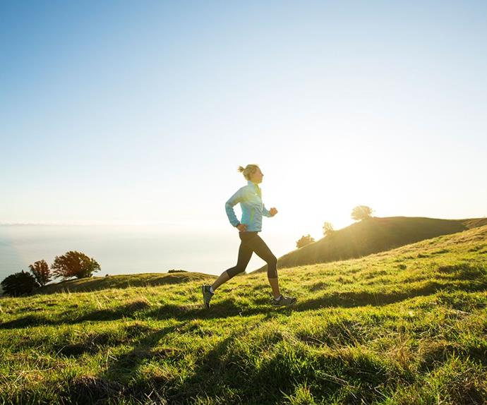 woman running in the morning on a hill