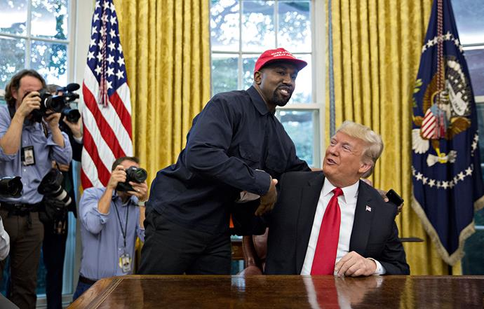 Kanye made himself at home in the Oval Office when he met with Donald Trump in October 2018. *Image: Getty*