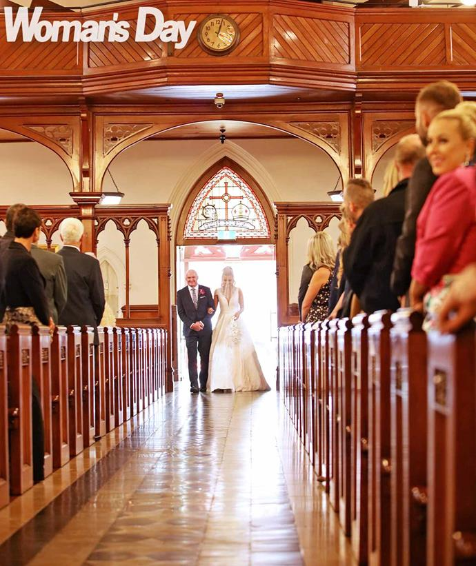 Dad Trevor excorts an excited Erin down the aisle at the historic St Patrick's Cathedral. *Photo: Robert Trathen*