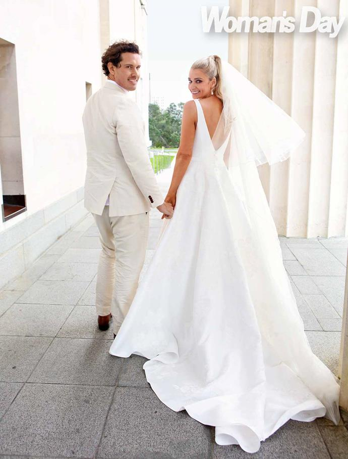 Erin loved the regal, traditional look of her wedding dress. *Photo: Robert Trathen*