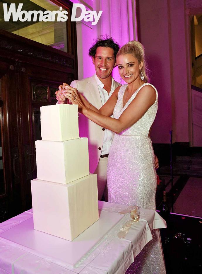 Cutting the three-tiered wedding cake. *Photo: Robert Trathen*