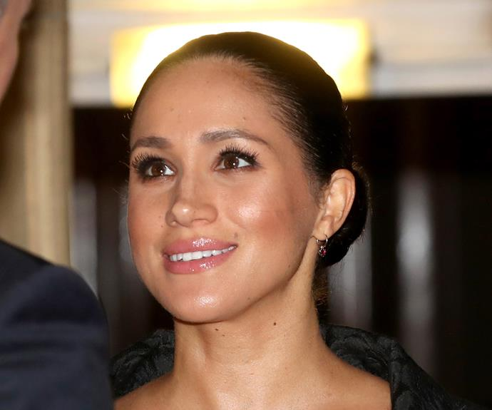 Meghan opted for the delicate ruby heart-shaped earrings by Kiwi designer Jessica McCormack. *(Image: Getty)*