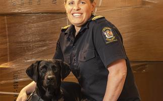 Customs officer Debbie Baldock and dog Ash
