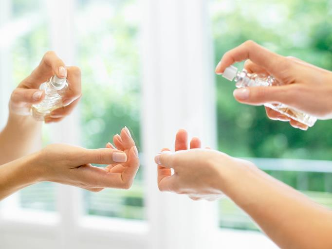 One of the biggest myths about perfume is that you should rub your wrists together afterwards. Instead, spritz it and let it settle. *(Image: Getty)*