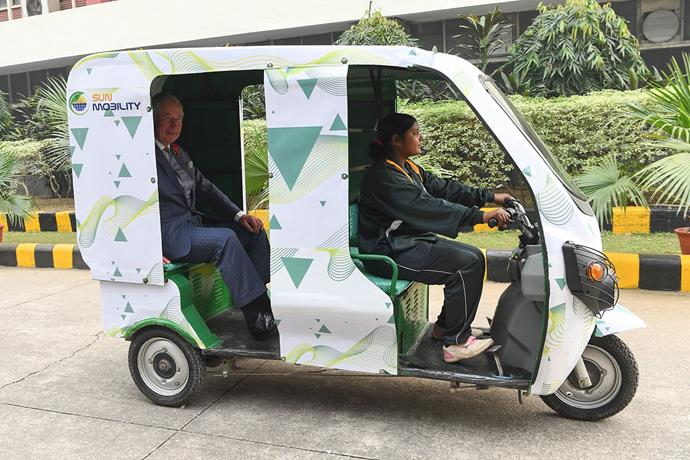 Prince Charles rides an electric rickshaw in New Delhi, India. *(Image: Getty)*