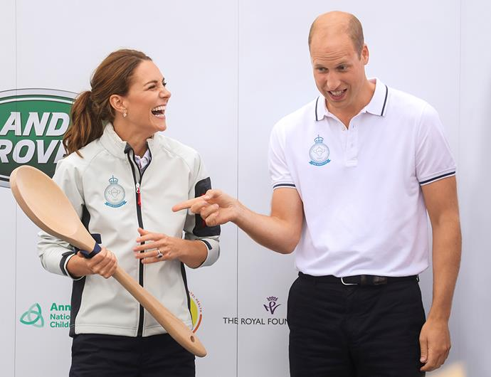 Prince William presents his wife with the wooden spoon at the King's Cup.