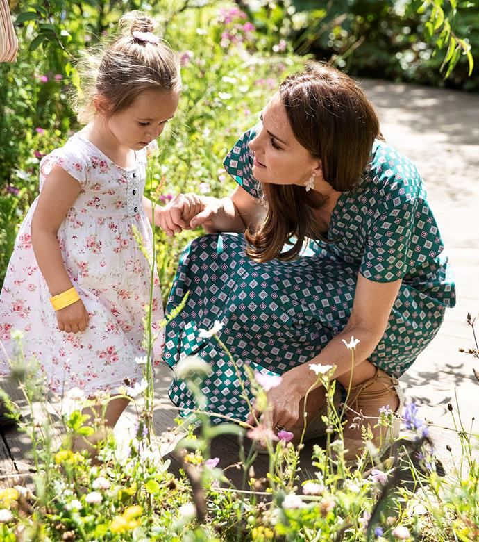 Duchess Catherine explores the Back to Nature Garden with a student from Hampton Hill Junior School.