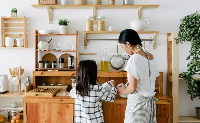 Mum and daughter baking in kitchen