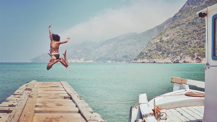 Woman Diving Into Sea From Pier