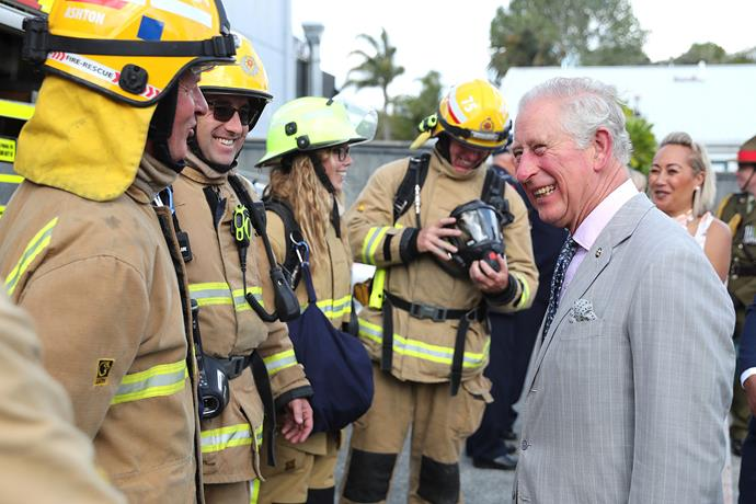 Prince Charles visits firefighters at the local fire station in Paihia. *(Image: Getty)*