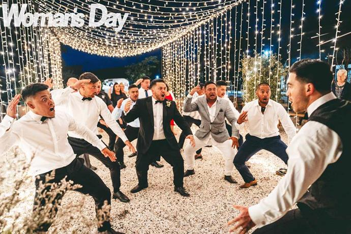 The newlyweds are treated to a moving haka by family. *Image: Laval Photo and Video.*