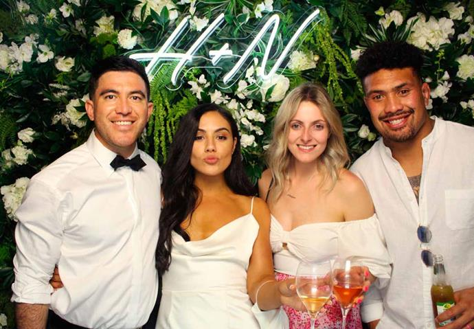 The newlyweds with Ardie and Saskia Savea in front of a custom neon sign by Light Lab NZ. *Photo by Wild Mint NZ*