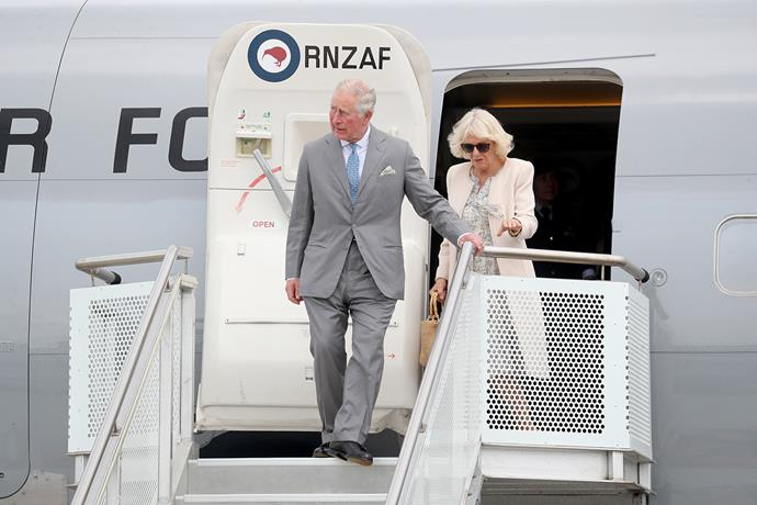 Prince Charles and Duchess Camilla land at the RNZAF base at Whenuapai, Auckland on Sunday, 17th November. *(Image: Getty)*