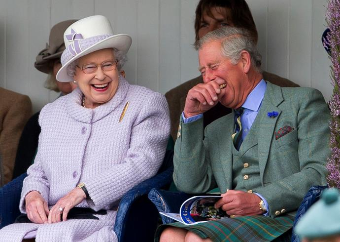 The Queen and her eldest son and heir Prince Charles sharing a laugh. *(Image: Getty)*
