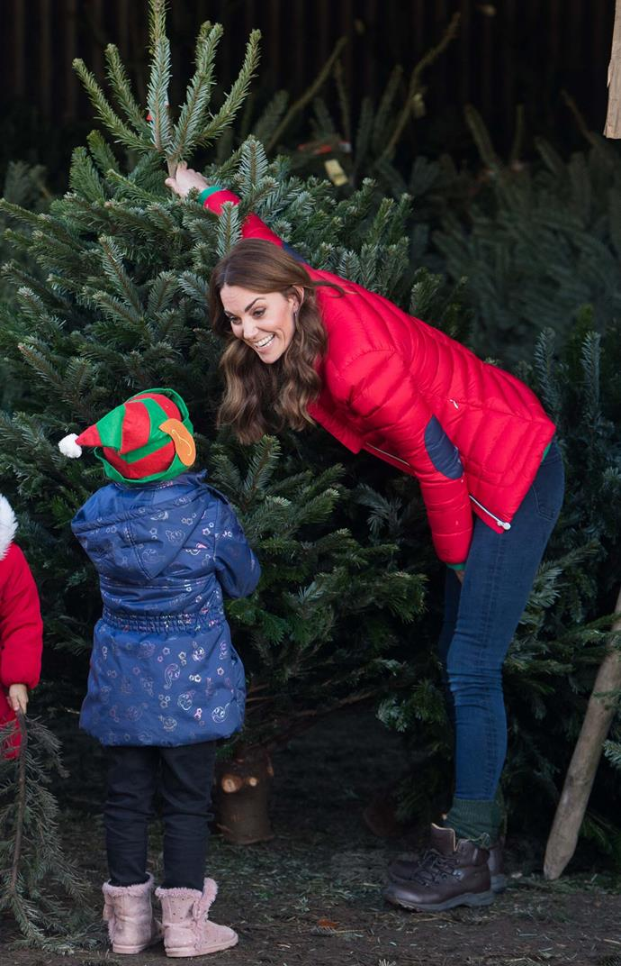 "The owner of the Christmas tree farm said Kate was ""fantastic"" with the children and wasn't afraid to get stuck in when handling the trees. *(Image: Getty)*"