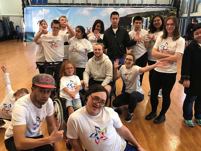 Benjiro (in his wheelchair) with his workshop, West Dazzling Dance, in Auckland. Benjiro is pictured with a mix of other jammers, volunteers and StarJam staff.