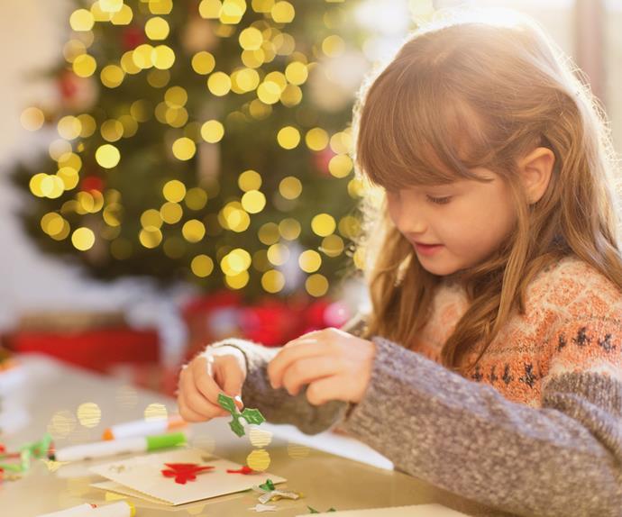 young girl doing Christmas crafts