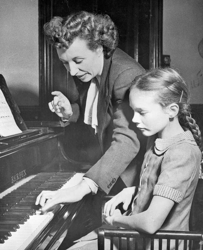 Young Julie learning the piano with mother Barbara in 1947.