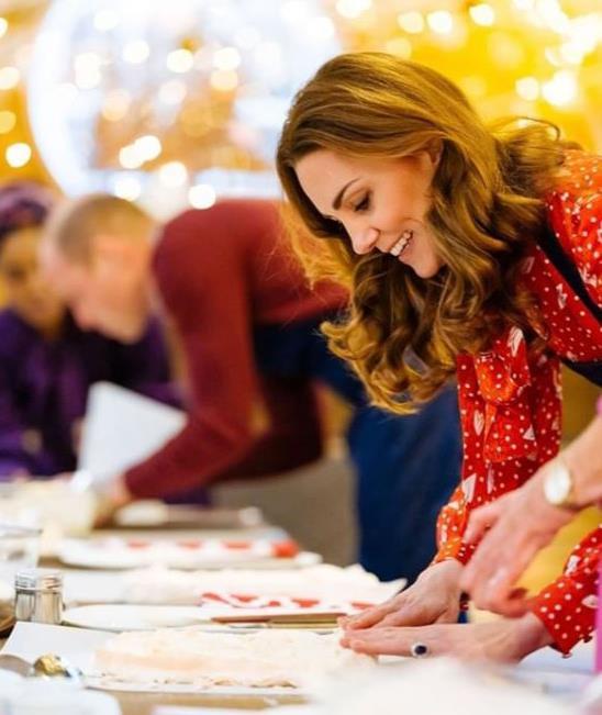 Duchess Catherine rolls her Christmas roulade. *(Image: Matt Porteous via @KensingtonRoyal)*