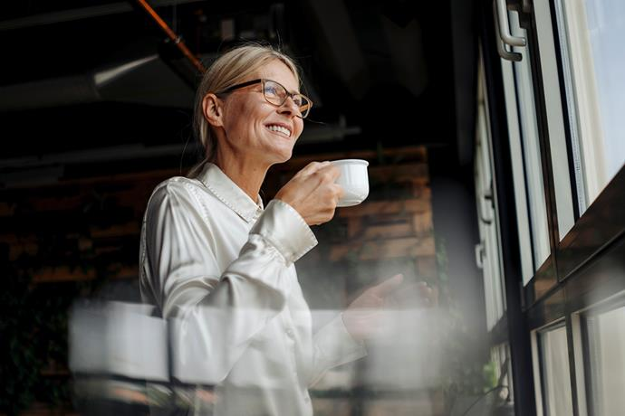 Marisa suggests slowing down and practising being present to all the things you're doing. Whether that's drinking your morning coffee slowing and paying attention to how it tastes, to even when you're on Instagram - taking time to really take in a photo, rather than quickly scanning it and scrolling on. *(Image: Getty)*