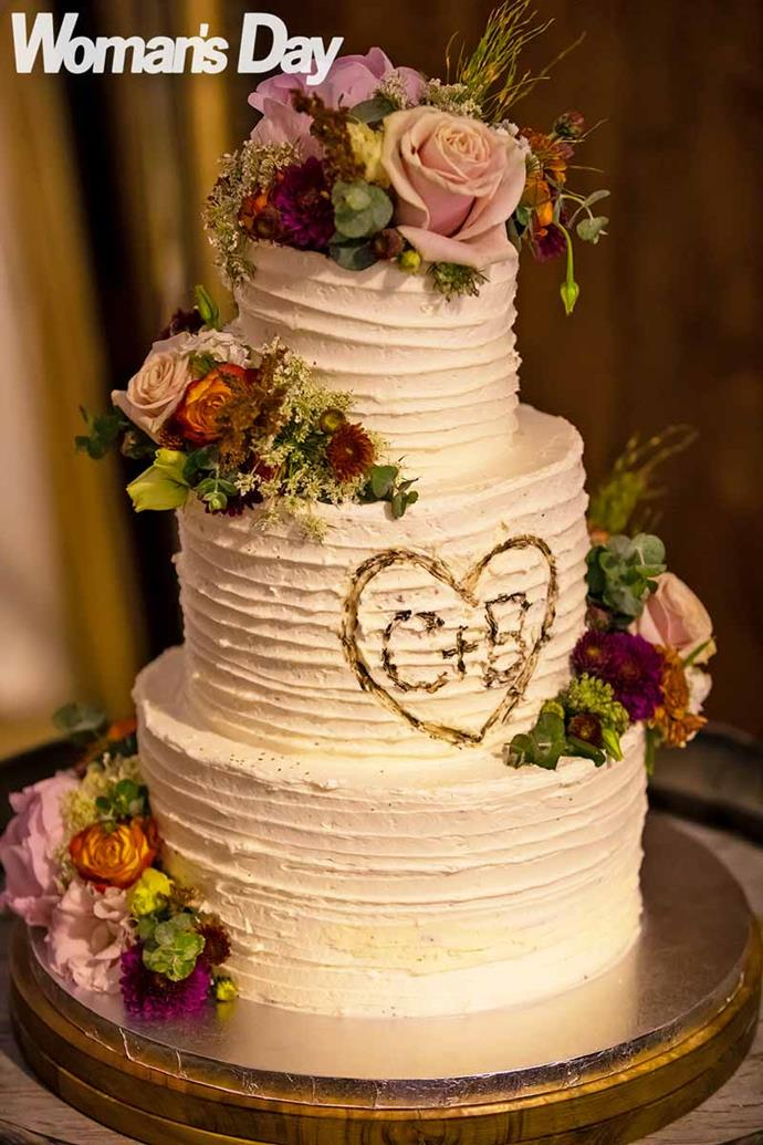 The couple's initials adorn their gorgeous three-tier cake.